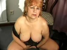 Busty grandma showing her old cunt