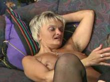 Grandma in stockings sexing on sofa
