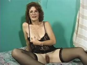 Nice horny mature in black lingerie sucks fat cock