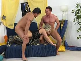 Mama in stockings gangbangs with two horny studs