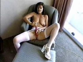 Mom in stockings treating her cunt with vibrator