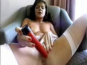 Lonely aged lady in stockings plays with red dildo