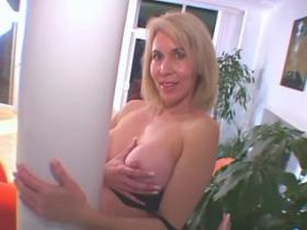 Charming blond mommy throats hard black weenie