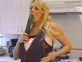 Big titted milf plays with strawberry and cucumber