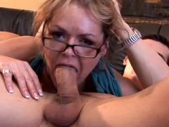 Fiery milf in high boots fucks brains out on sofa