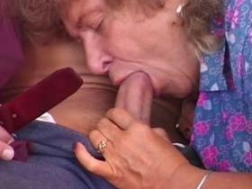 Nasty granny getting fucked with a long cucumber