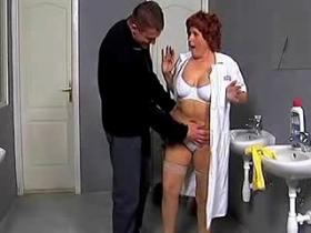 Old charlady goes horny with young manager in WC