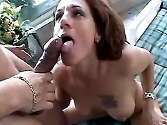 Cute milf gobbles jizz after facial