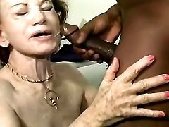 Lustful grandma gets cum on face