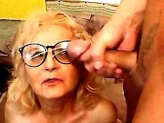 Lustful granny gets cum on glasses