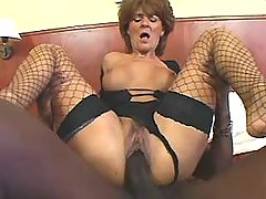 Old lady in stockings fucked by huge chocolate cock